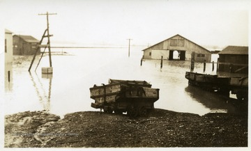 Mule barn and surrounding buildings are flooded.