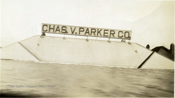 The Chas. V. Parker Co. filling station under water up to the roof.