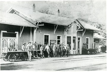 C&O depot in Alderson W. Va. Men standing outside left to right: Moody Hokins, Harold Flack, Fred Patton, Floyd Thomas, Frank Bordurant, Agent T.L. Jamison, unknown, unknown, Freight Agent W.A. Hancock, J.C. Boggs (in doorway.)