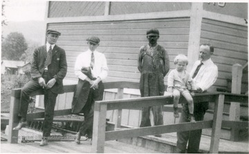 "Telegrapher W.L.Knopp stands on right. Tower was known as ""AD Cabin"" and controled train movements between Ronceverte and Hinton. Twenty switches to Alderson sidings were operated here."