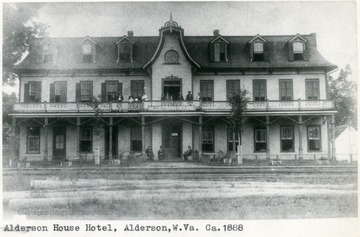 'The Alderson House Hotel was built at Alderson, West Virginia (Monroe County) in 1882 by Messrs. David J. Cogbill and John W. Alderson. It was located in close proximity to the main line iron of the Chesapeake [and] Ohio Railway. It was the most modern hotel in the state of West Virginia on the C [and] O line when it was built, having 26 rooms and two annexes, adding about 15 rooms. It was the first building in Alderson to have running water in every room, it being supplied from a 7,000 gallon tank located just above the third story of the hotel. It recieved much praise from Virginia Newspapers in the '80's who always referred to it as the best and most famous house on the C and O in West Virginia except for the White Sulphur Hotel. In addition to the regular guests and boarders, two C [and] O passenger trains each day stopped for meals in the hotel's dinning room. One express passenger train stopped for breakfast and one for supper, there being about 200 people from the steamcars taking meals in the fine dinning room. The Alderson House took over the passenger business which had from 1872 to 1882, been handled by the Monroe House Hotel, which was located across the street on the other side of the rails.  The Alderson House continued as a eating stop on the C [and] O until the middle 1890's and after that became principally a summer resort. By 1896 the town of Alderson had huge swarms of people coming in from the Virginia and Ohio cities to spend the summer in the cool, pleasant mountains. This traffic reached a height about 1900. By 1912 there were few summer boarders. During this period the Alderson House got more than its share of the trade. It continued as a popular stop until the 1930's when rail travel slowed down considerably. The hotel operated under many different managers after Mr. J.W. Alderson gave up the management in 1905 and did not close down until 1961. Compiled by Thomas W. Dixon, Official Historian to the Municipal Government of the Town of Alderson, Inc.'