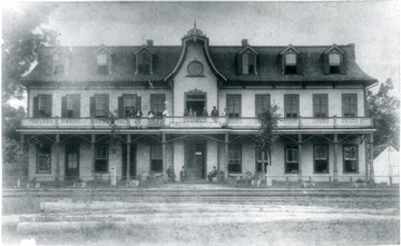 'The Alderson House Hotel was built at Alderson, West Virginia (Monroe County) in 1882 by Messrs. David J. Cogbill and John W. Alderson. It was located in close proximity to the main line iron of the Chesapeake [and] Ohio Railway. It was the most modern hotel in the state of West Virginia on the C [and] O line when it was built, having 26 rooms and two annexes, adding about 15 rooms. It was the first building in Alderson to have running water in every room, it being supplied from a 7,000 gallon tank located just above the third story of the hotel. It recieved much praise from Virginia Newspapers in the '80's who always referred to it as the best and most famous house on the C [and] O in West Virginia except for the White Sulphur Hotel. In addition to the regular guests and boarders, two C [and] O passenger trains each day stopped for meals in the hotel's dinning room. One express passenger train stopped for breakfast and one for supper, there being about 200 people from the steamcars taking meals in the fine dinning room. The Alderson House took over the passenger business which had from 1872 to 1882, been handled by the Monroe House Hotel, which was located across the street on the other side of the rails. The Alderson House continued as a eating stop on the C [and] O until the middle 1890's and after that became principally a summer resort. By 1896 the town of Alderson had huge swarms of people coming in from the Virginia and Ohio cities to spend the summer in the cool, pleasant mountains. This traffic reached a height about 1900. By 1912 there were few summer boarders. During this period the Alderson House got more than its share of the trade. It continued as a popular stop until the 1930's when rail travel slowed down considerably. The hotel operated under many different managers after Mr. J.W. Alderson gave up the management in 1905 and did not close down until 1961.'