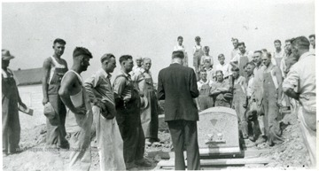 'Blessing of the grave, prior to lowering Mother Jones to new grave at new memorial.'