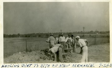 Workers load dirt into wheelbarrows for the Mother Jones Memorial at the Miner's Cemtery, Mt. Olive, Ill.
