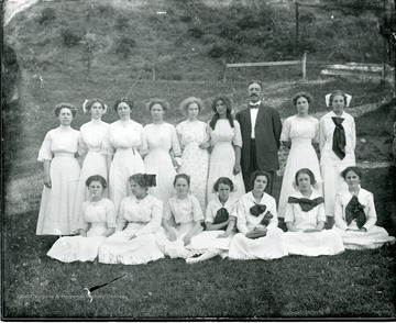 Teacher E. Chase Bare is standing with female Alleghany Collegiate Institute students. Dorothy Gish is second from left from Mr. Bare.
