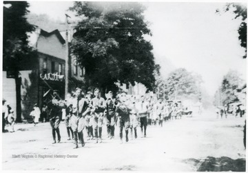 Camp Greenbrier Military Band marching in the July, 4th parade on Railroad Avenue, Alderson, W. Va.