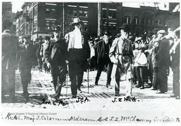 J. Coleman Alderson and others in the streets of Charleston. Col. J. Z. McChesney is on his right.