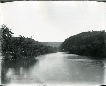 View of Greenbrier River from bridge at Alderson.  Road visible in the distance.