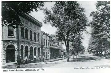 People standing outside of buildings on Railroad Avenue, South Alderson, W.Va.  'Given by Virgil Burns.'