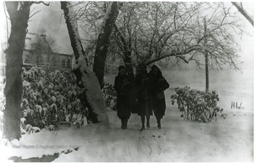 'Annabelle Mayor, Glenna Williams, and June Williams Mayfield walking to school in the snow.