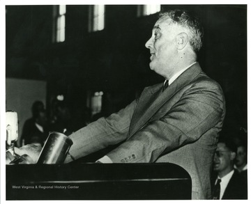 View of President Roosevelt speaking at Arthurdale High School in Preston County, West Virginia. 'A print form the Franklin D. Roosevelt Library Collection.  This print is furnished for your file and must not be reproduced without the owner's permission.'