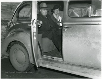 Eleanor Roosevelt in car with two men in Arthurdale, W. Va.