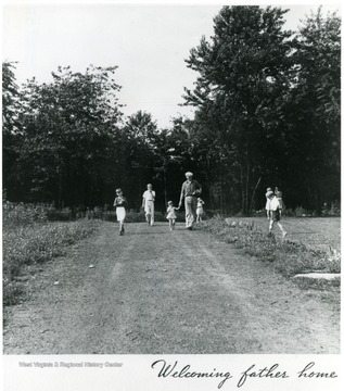 "Children walking with father on country road. Title,""Welcoming Father Home"". Information on the back of the photograph,'A print from the FDR Library collection This print is furnished for your file and must not be reproduced without the owner's permission. Album 359 FSA - Arthurdale W. Va.'"