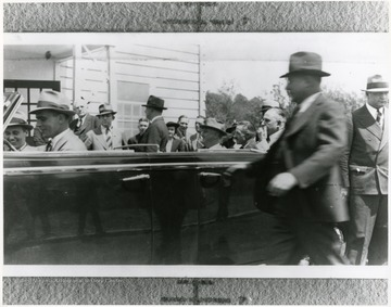 Large crowd gathers around car with FDR and others in Arthurdale W. Va.