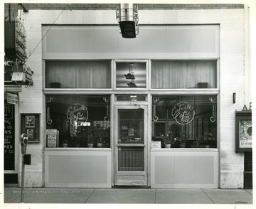 View of the entrance to the Eatwell Cafe in Beckley, West Virginia.  'Copyrighed 1955 All rights reserved by Harlow Warren 320 North Kanawha Street Beckley, W. Va.'