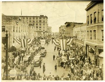 People fill the streets for the 100 Anniverary Celebration. 'Copyrighted 1955, All Rights Reserved By Harlow Warren, 320 North Kanawha St., Beckley, W. Va.'