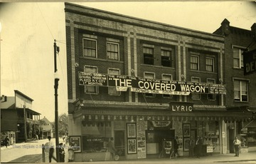 Banner hangs across the top of the Lyric Theater to announce that the motion picture Covered Wagon is played for the first time in Beckley, West Virginia.