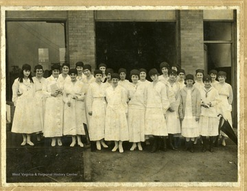 Group portrait of Beckley's WWI American Red Cross Workers wearing white dresses.