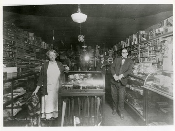 Customers and dog pose inside Alfred's Store in Poca, West Virginia.