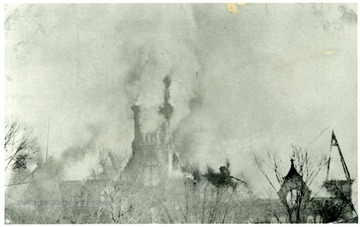 From a postcard. The top of the W. Va. State Capitol building engulfed in flames.