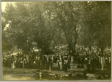 Large group of people gather together under trees in Charleston, W. Va.