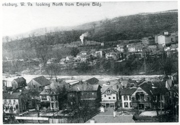 Houses line Pike Street in Clarksburg.  Glen Elk area is visible in background.