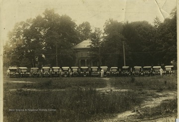 Physicians stand next to their cars in Clarksburg, W. Va. 'Left to right: 1. Esker, 2. Lynch, 3. Carbin, 4. D.B. Davis, 5. Dhrutleworth, 6. Unknown, 7. Corder, 8.Unknown, 9. E. N. Flowers, 10. Sloan, 11. Slatter, 12. Unknown, 13. Nutter, 14. Unknown, 15. Showalter, 16. A. L. Post.'