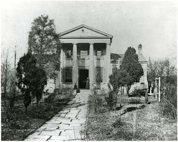 Home of Waldo P. Goff.  Large house with columns.  Two women visible on the front porch.