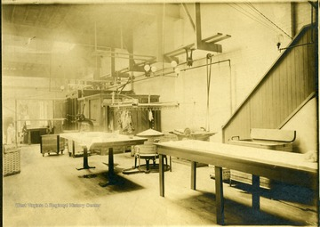 View of the interior of the Empire Laundry Company in Clarksburg showing tables and other equipment.