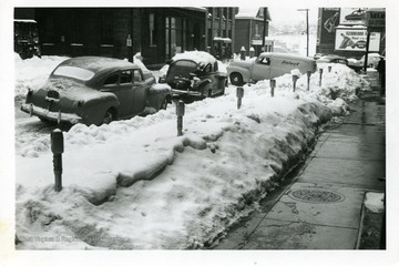 Cars are parked along Monroe Street in Fairmont, West Virginia during the big snow storm of 1950.