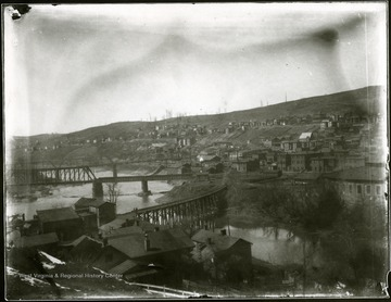 View of Grafton, W. Va. showing buildings on a hillside and bridges.