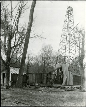 Oil well with building around it.