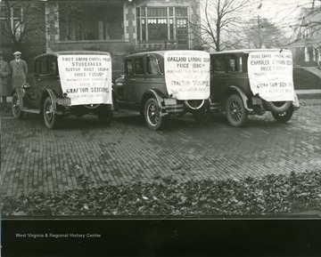 Custom built Studebaker, Oakland Landau Sedan, and a Chandler Standard Sedan, three automobiles given as prizes by the Grafton Sentinel Publishing Company during a circulation drive.