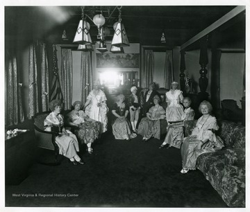 Ladies Aid Society members in costume sit for a group portrait at Andrew's Methodist Episcopal Church in Grafton, West Virginia.