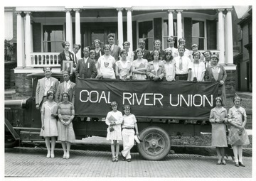 Members of the Coal River Union pose in and around their float in Grafton, West Virginia.