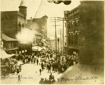 People fill the Main Street in Grafton, W. Va.