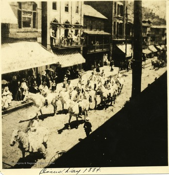A group on horses ride down Main Street Grafton on Circus Day.