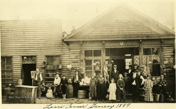 Group of people stand in front of the Love's Corner Grocery in Grafton, W. Va.