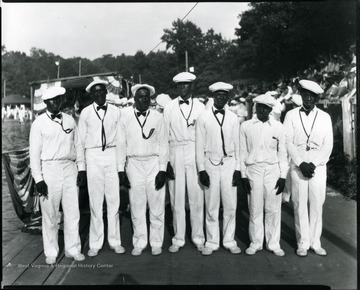 African-American men dressed up in their uniforms line up for a group portrait.