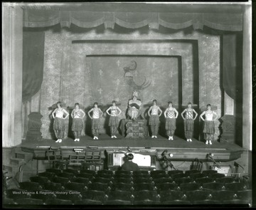 Members of the LaSalle Musical Comedy Troupe of Grafton, West Virginia, in costume on stage.