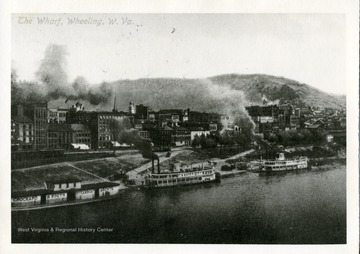 Steamboats along the shore of the Wharf district in Wheeling, W. Va.
