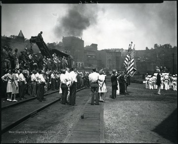 Men, women, and children gather at a ceremony at the Baltimore and Ohio railroad yard in Grafton, W. Va.