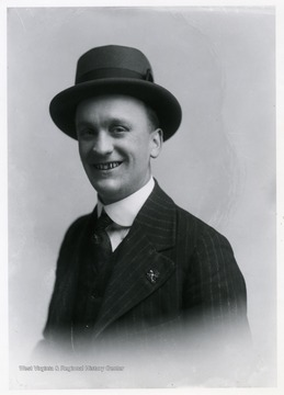 Men wearing a hat and a three-piece suit.