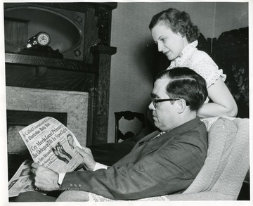 Senator Rush D. Holt and his wife, Helen, are reading the Charleston Daily Mail.