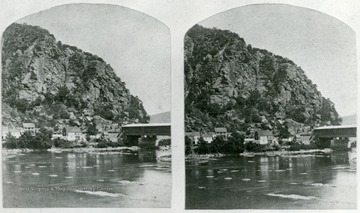 View of Maryland Heights from across the Potomac River and the covered railroad bridge at Harpers Ferry, Virginia,, later West Virginia, before 1861 and the Civil War.