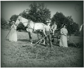 Gottfried, Olga, Walter, and another Aegerter working with a horse and rakes.  Helvetia, W. Va.