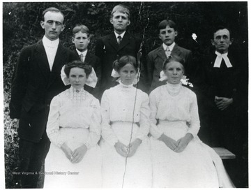 Subjects identified: The Reverend Benjamin Holtkamp, far left; The Reverend Ernest Preuss, far right; Minnie Betler; Ida Marti; Della Vogel; William Daetwyler; Frank Huppertz; Hugo Schleuniger;.