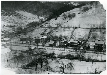 Snowy view of Helvetia, W. Va.  Numbered spots:  1) church 2) Huber hotel 3) parsonage.