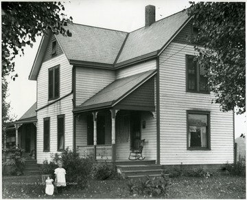 Reverend Benjamin Holtkamp home, Mitawanga, Ohio, daughter Grace in the front yard.