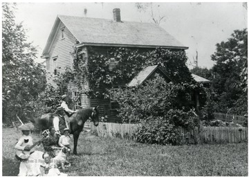 Aegerter Home, front to rear: Olga Aegerter, unknown, Marianna Aegerter, Walter Aegerter, Gottfried Aegerter, unknown.  Helvetia, W. Va.